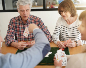 Adults playing cards